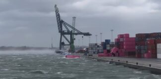 a Strong winds topple containers in the port of Antwerp