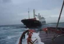 Tug Boat Crew Working in Rough Sea